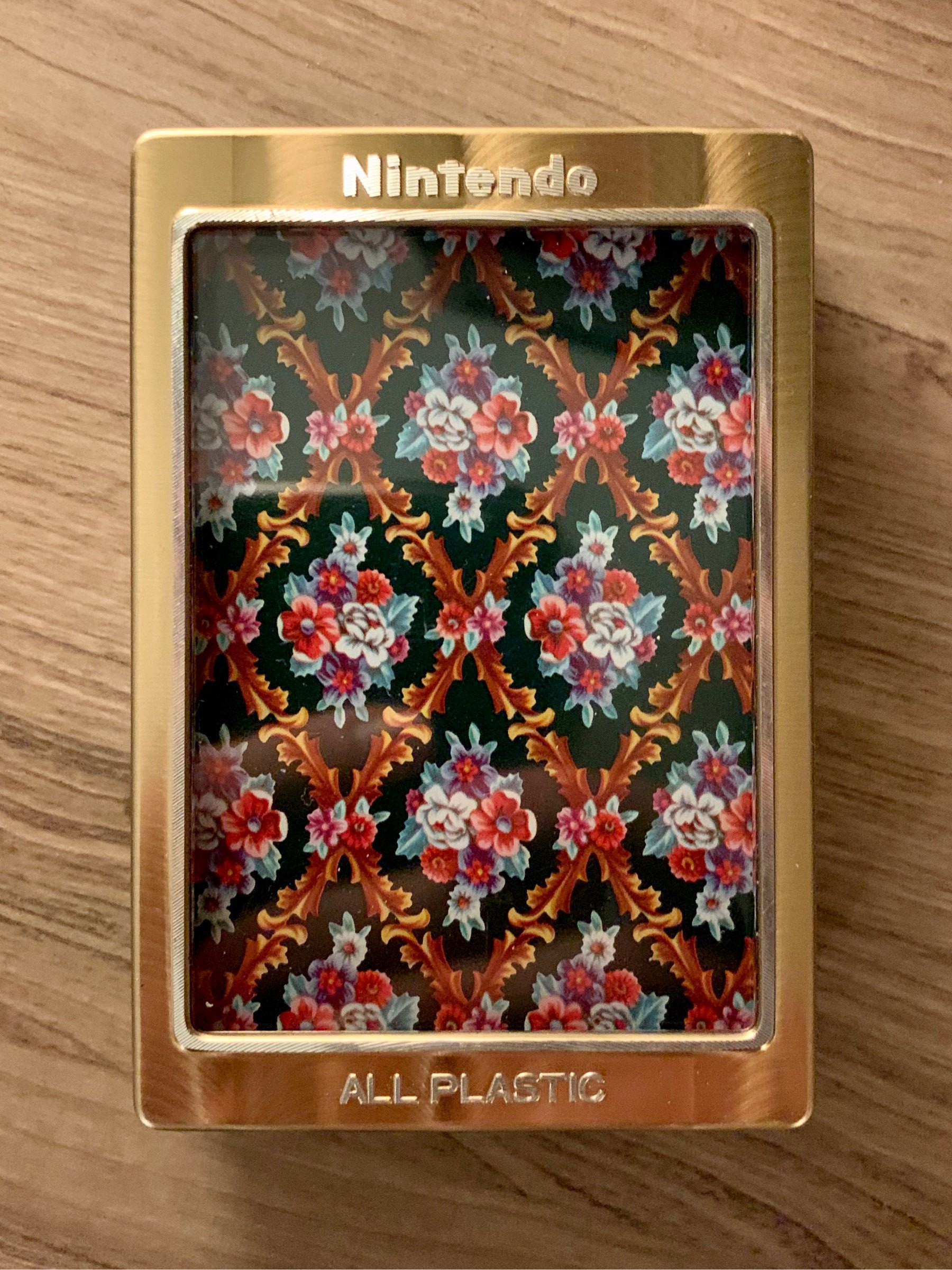 Playing cards in a Nintendo-branded plastic box