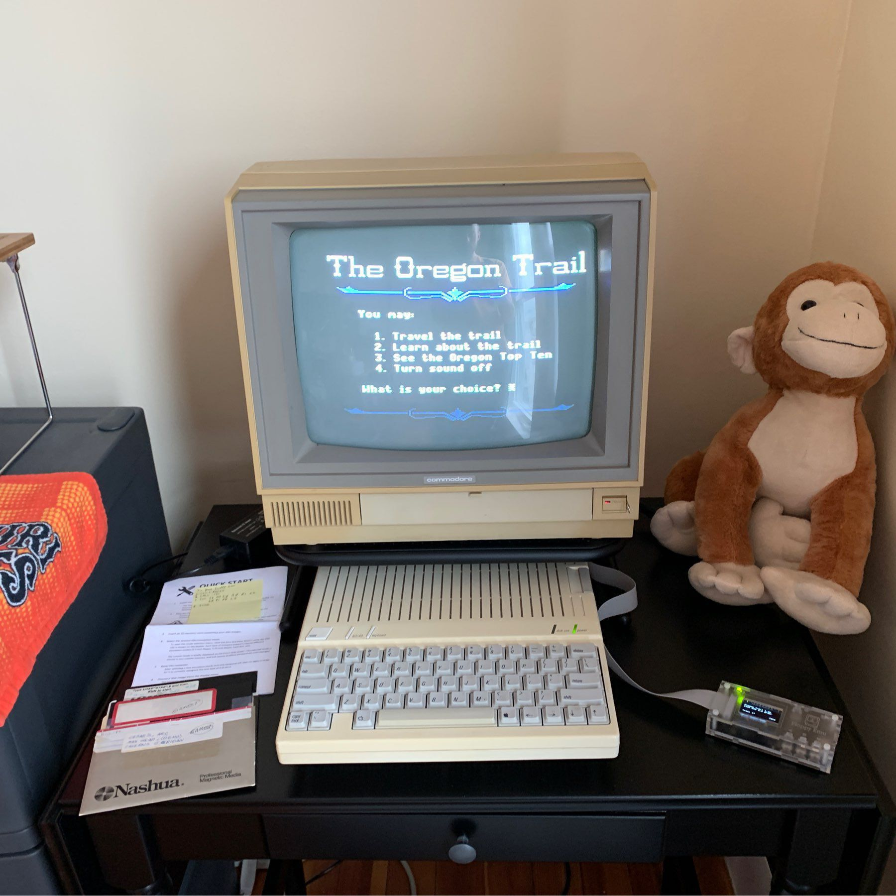 Apple 2c running Oregon Trail off of a floppyemu