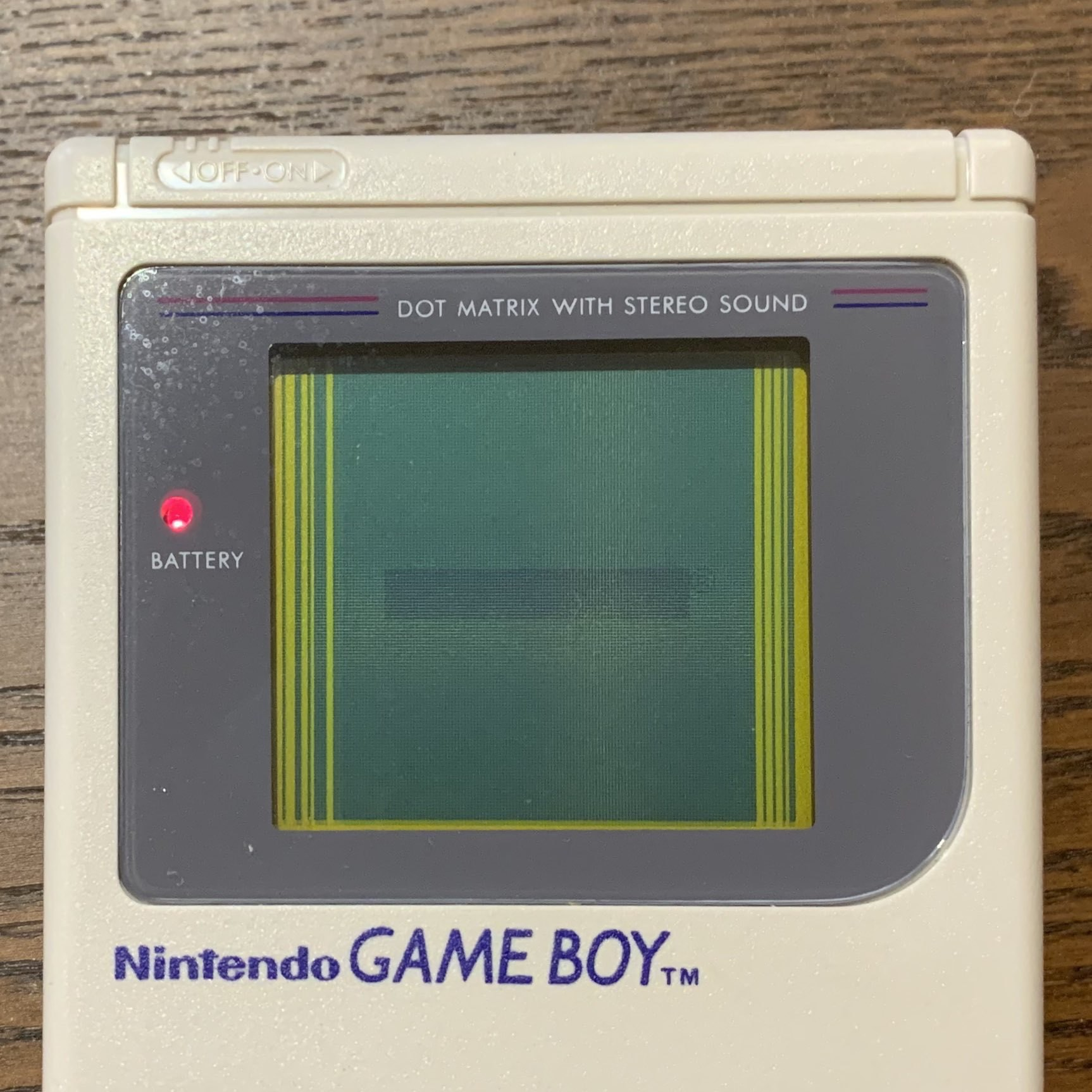 original game boy with dead lines on screen